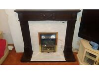 Gas fire place and solid surround