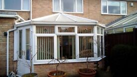 Conservatory complete with vertical window and ceiling blinds.