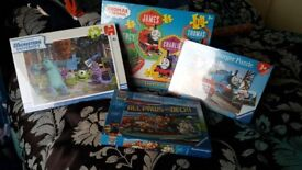 Unopened kids puzzles.. perfect addition to christmas presents