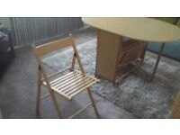 Folding dinning table and 4 chairs never been used