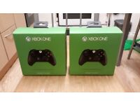 2 Xbox one controllers (brand new in the box).