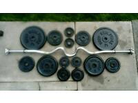Ez W bar and 38.5kg of metal weight plates