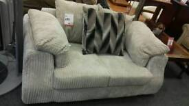 Small two seater grey sofa