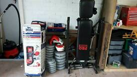 Workout bench and punch bag
