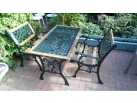 BEAUTIFUL CAST IRON & WOOD GARDEN TABLE & 2 BENCH CHAIRS - GOOD CONDITION