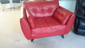 Red leather cuddle chair, good condition has the odd mark on it