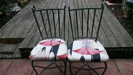pair of ornate metal chairs