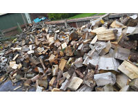 Seasoned logs, large to small/ sold per ton bag, fire wood