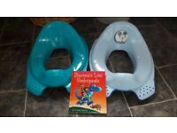 "2 potty training seats and ""Dinosaurs Love Underpants"" book"