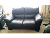 Unblemished and comfy Black Leather Two Seater Settee in very good condition.