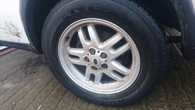 "Land Rover Discovery 2/Range Rover 18"" alloys with tyres 3-5mm of tread with nuts and locking nuts."