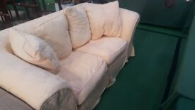 Light light yellow chunky two seater sofa