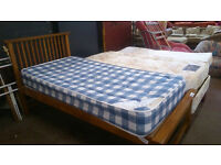 Single wood framed bed with mattress