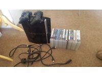Ps3 with 2 controllers and over 20 games