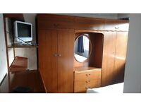 two wardrobes dressing table and chest of draws