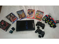 Playstation 2 with 5 games