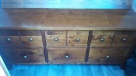 Dark wood storage chest from Next with drawers and a flip top back