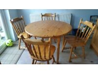 Pine round kitchen table and four chairs