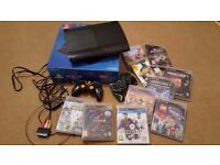 PS 3 in box, 10 games, 2 controllers