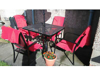 Garden furniture: table, four chairs and umbrella