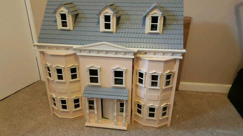 Victorian dolls house with dolls and furniture