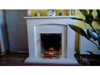 Electric fire and surround. Good condition. Offers around fifty pounds.