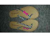Brand new never worn flip flops size 4