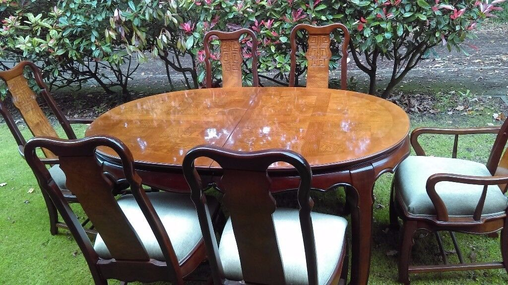 Large extending dining table and 6 chairs ( two carvers) IMPERIAL DYNASTY