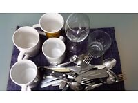 Cutlery, forks, knife, spoons, mugs, wine glass