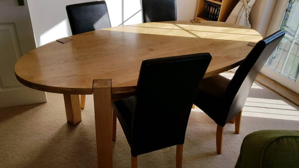 Solid Oak Dining Table And 4 Leather Effect Chairs In