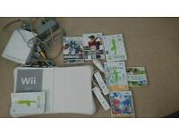 Wii console, balance board plus games