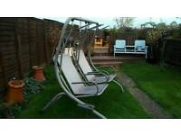 Garden patio swing with canopies and cushions
