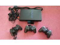 PS2 with controllers, memory cards, various games and official strategy guides.