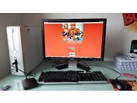 "Dell Desktop with a 24"" 1080p HD monitor, multimedia keyboard"