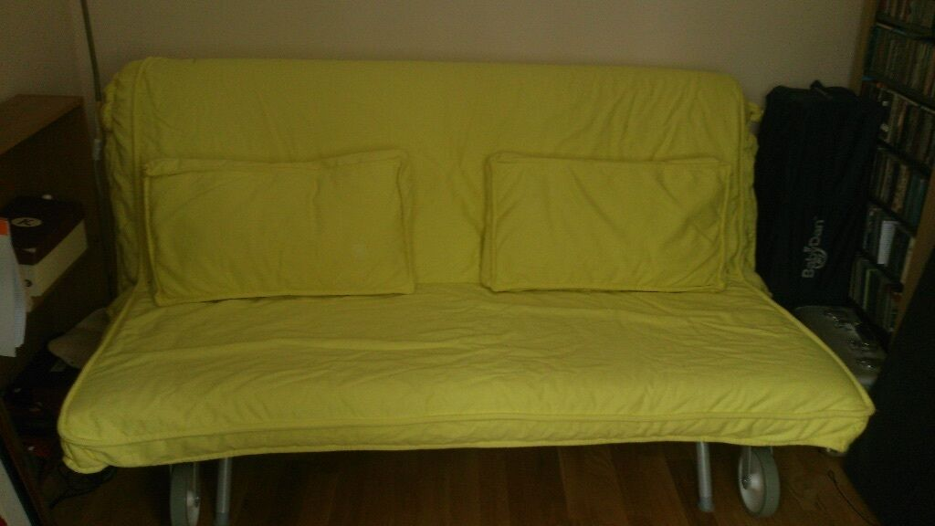 ikea king size sofa bed with yellow cover and cushions