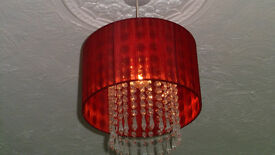 Ceiling light shades in red with crystals in the centre