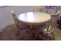 Extending round table and chairs