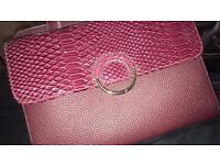 Burgundy clutch and hand bag