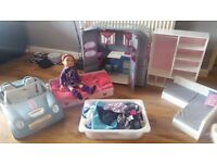 Doll and accessories for sale. Includes bed,clothes and shoes,caravan,wardrobe and car...