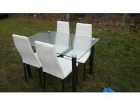 Glass table four white leather chairs