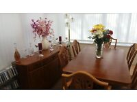 Extending Dining Table with six chairs inc two Carvers and sideboard