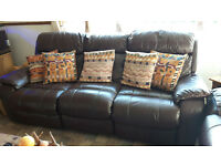 large chocolate brown leather thee and two seater settee with electric recling