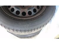 VERY GOOD CONDITION 4 STEEL WHEELS 16 INCH WITH VAUXHALL COVERS ASTRA
