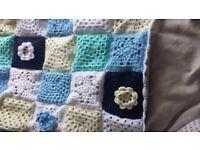 Hand knitted crochet baby blanket blue