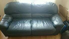 2 x blue leather sofas