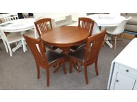 Julian Bowen Round to Oval Extending Table & 4 Chairs Can Deliver