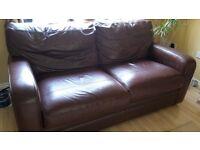 Dark leather sofa (Slight sun damage)