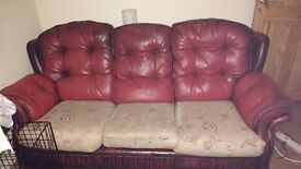 Leather and fabric sofa and 2 armchairs