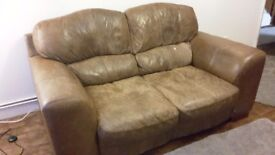 2 seater brown leather sofa going free.
