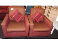 a pair of red/gold striped lounge chairs